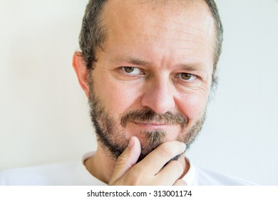 Man with beard and mustaches, skeptic expression