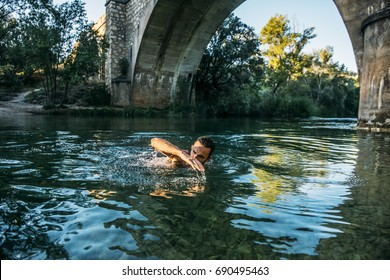 Man with beard on the river swimming