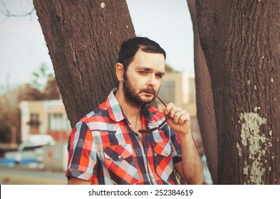 man with beard in the park with casual clothes