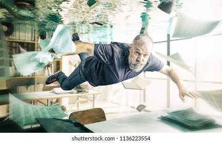 man with beard swimm in floaded library