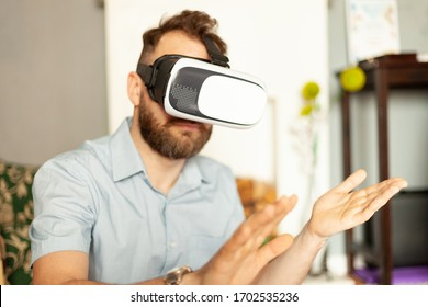 man with a beard in VR glasses, virtual reality concept