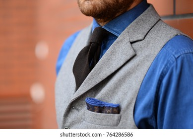 man with beard wearing elegant clothes