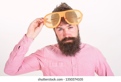 Man bearded guy wear giant louvered sunglasses. Eye protection sunglasses accessory concept. Sunglasses party attribute and stylish accessory. Hipster wear shutter shades extremely big sunglasses.