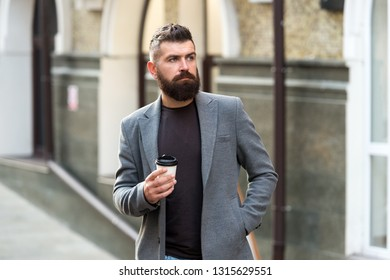 Man bearded hipster drinking coffee paper cup. One more sip of coffee. Drinking coffee on the go. Businessman lumbersexual appearance enjoy coffee break out of business center. Relax and recharge.