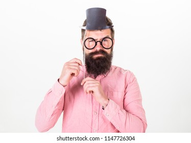 Man bearded hipster hold cardboard top hat and eyeglasses to look smarter white background. Tricks to seem smarter than you are. Guaranteed ways appear smarter. Signs someone is smarter than you.