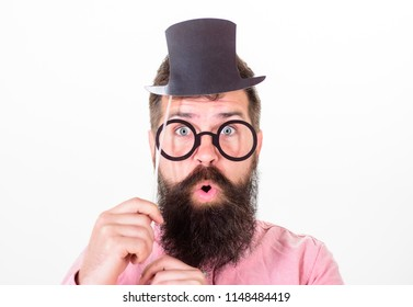 Man bearded hipster hold cardboard top hat and eyeglasses to look smarter white background. Signs someone is smarter than you. Tricks to seem smarter than you are. Guaranteed ways appear smarter.
