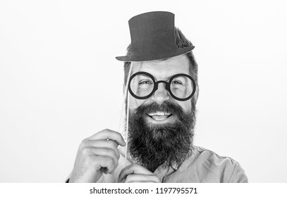 Man bearded hipster hold cardboard top hat and eyeglasses to look smarter white background. Dress affects how people see you. Guaranteed ways appear smarter. Tricks to seem smarter. Dress for success.