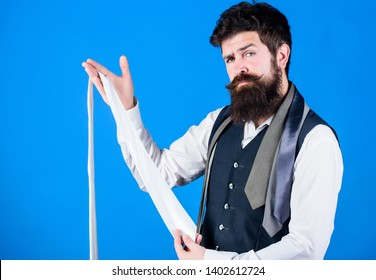 Man bearded hipster hold few neckties. Guy with beard choosing necktie. Perfect white silk necktie. How to select tie. When dressing in suit necktie often add dash of flavor to overall outfit.