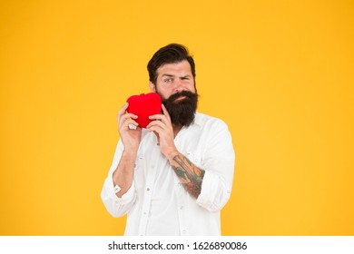 Man bearded hipster hold red heart toy. Medicine concept. Listen to your heart. Health Check helps understand risk factors for heart disease and estimate how likely have attack or stroke next years.