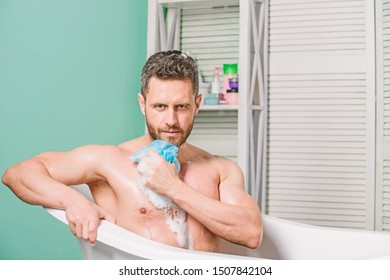 Man bearded hipster use sponge cleaning skin. Personal hygiene. Take care hygiene. Personal grooming is cleaning parts body. Hygiene concept. Bath have greater effect mood than physical exercise.
