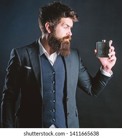 Man bearded hipster wear elegant suit hold metal flask for alcohol. Alcohol drink. Have alcohol drink with you. Always with me. Flat metal bottle for alcohol. Guy hold metal flask. Cheers concept.