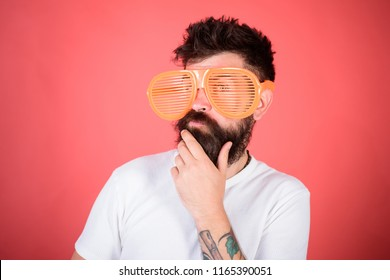 Man bearded hipster wears giant louvered sunglasses. Optics and eye protection concept. Hipster wear shutter shades sunglasses. Fashionable accessory. Sunglasses party attribute and stylish accessory.