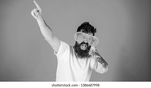 Man bearded hipster wears giant louvered sunglasses. Sunglasses accessory gives incredible feeling of confidence. Feel like superstar in that eyeglasses. Hipster wears shutter shades sunglasses.