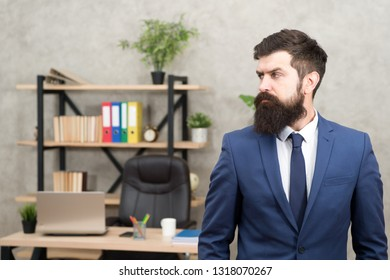 Man bearded serious office background. Provide consultation to management on strategic staffing plans. Office staff. HR director. HR management. HR job description. Head of human resources department.