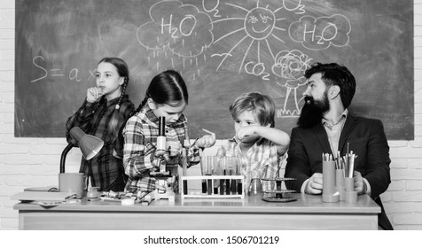 Man bearded teacher and pupils with test tubes in classroom. School chemistry lab. Science involves theory. School chemistry experiment. Explaining chemistry to kids. Fascinating chemistry lesson.
