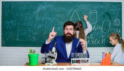 Man bearded teacher work with microscope and test tubes in biology classroom. School teacher of biology. Explaining biology to children. Biology plays role in understanding of complex forms of life.