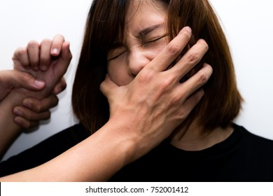 Man beat woman - touching her mouth - crime and violence concept