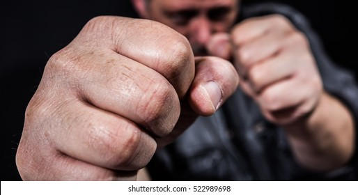 A man beats aggressively with his fists