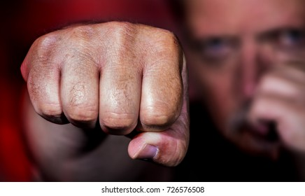 a man beats brutally with his fist