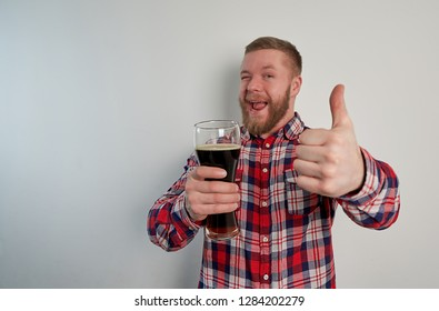 man with beer mug in hand on white background