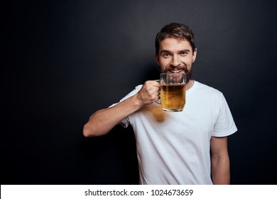 man with beer on a black background