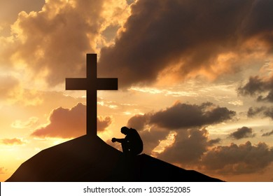 man before the cross, praying and worshiping the Lord God