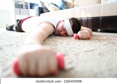 Man began to engage in sports since monday, did not calculate his strength and fell exhausted on carpet. First training most severe fainting from excessive loads anarexia and desire lose weight vegan