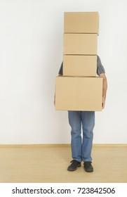 Man behind moving boxes