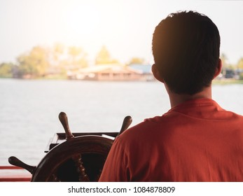 Man behind Ship steering looking for home