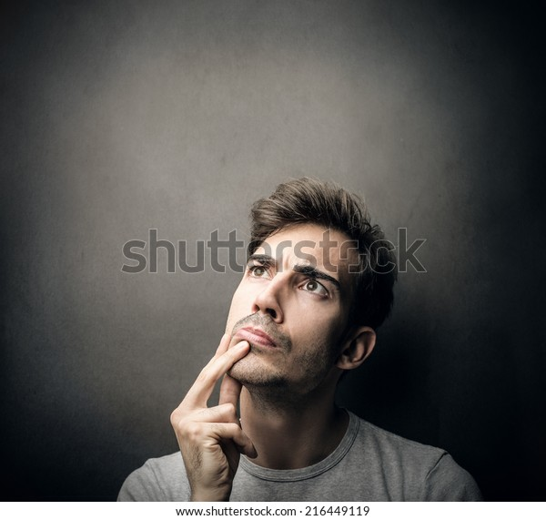 man being doubtful about something