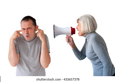 man being yelled at by senior woman on white