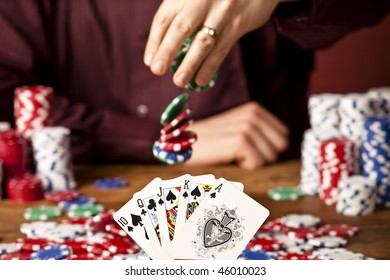 man betting against full house, focus on the cards