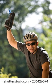 Man in a bicycle raising hand