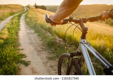 Man with bicycle riding country road. bicycle travel concept