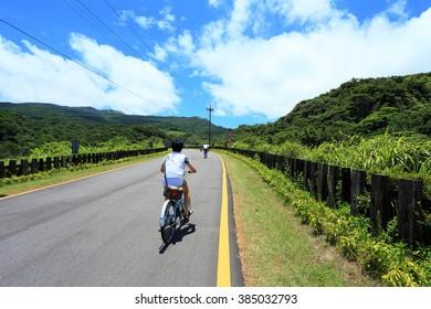 Man with bicycle riding at Fulong  Taiwan