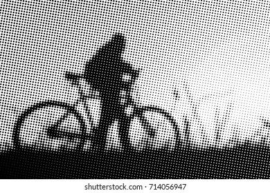 Man with bicycle at sunset - monochrome halftone pattern background