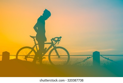 man and bicycle with sunset vintage color