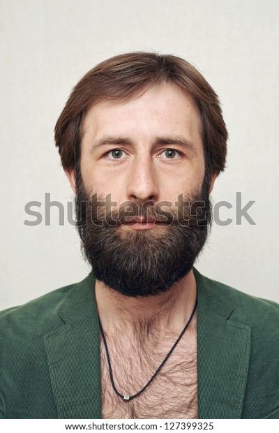 The man with a big beard and moustaches