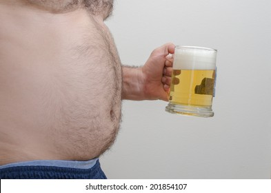 Man with big belly holding a beer