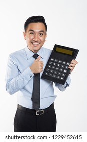 Man with big calculator shows thumbs up