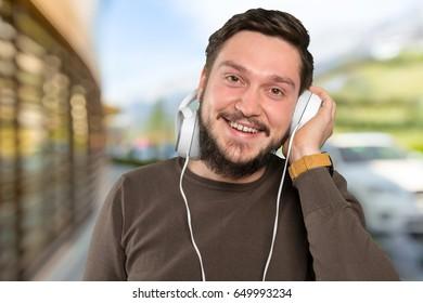 man in big headphones listening music