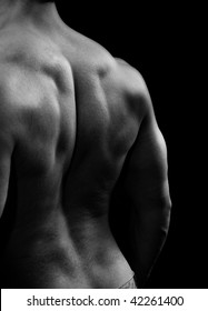 Man with big muscular back in black and white style