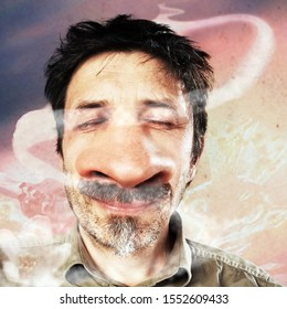 Man with big nose concentrates on smelling