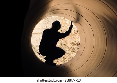 man in a big pipe 2