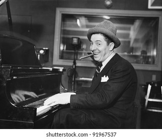 Man with a big smile and a cigar in his mouth playing the piano