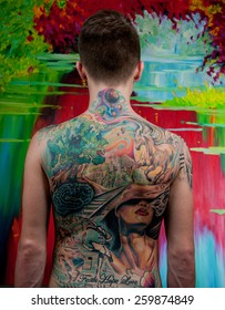 Man with a big tattoo on her back