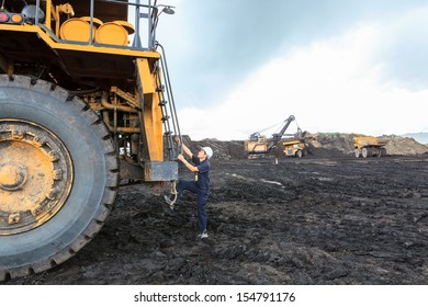 Man  big Truck Driver in Open Pit