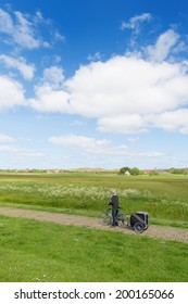 Man with bike in Dutch landscape