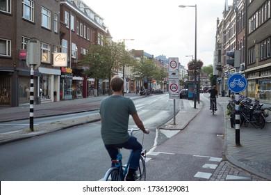 Man biking in Utrecht, Netherlands, september 2019