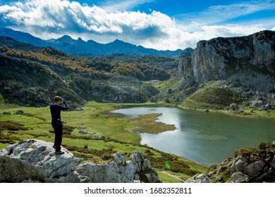 Man with binoculars gazing a beatiful lake